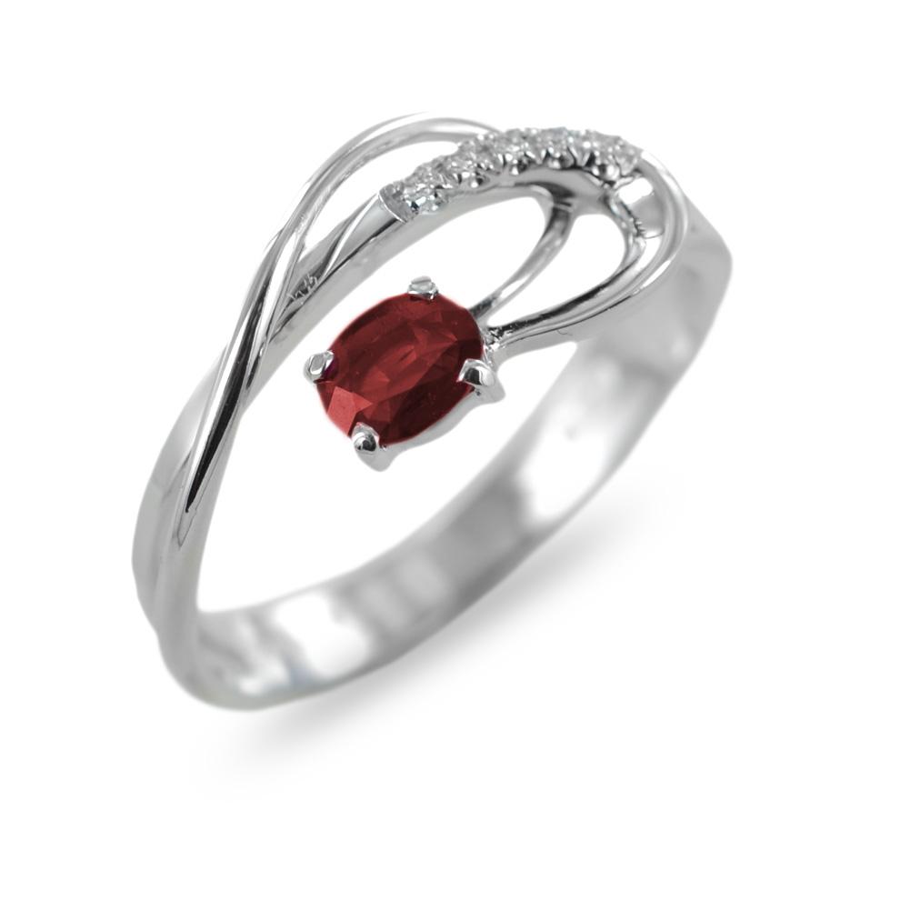 Anello in oro con diamanti e rubino ct 0.45