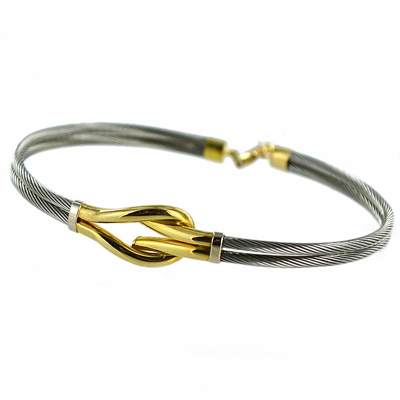 Bracciale rigido in acciaio e oro giallo
