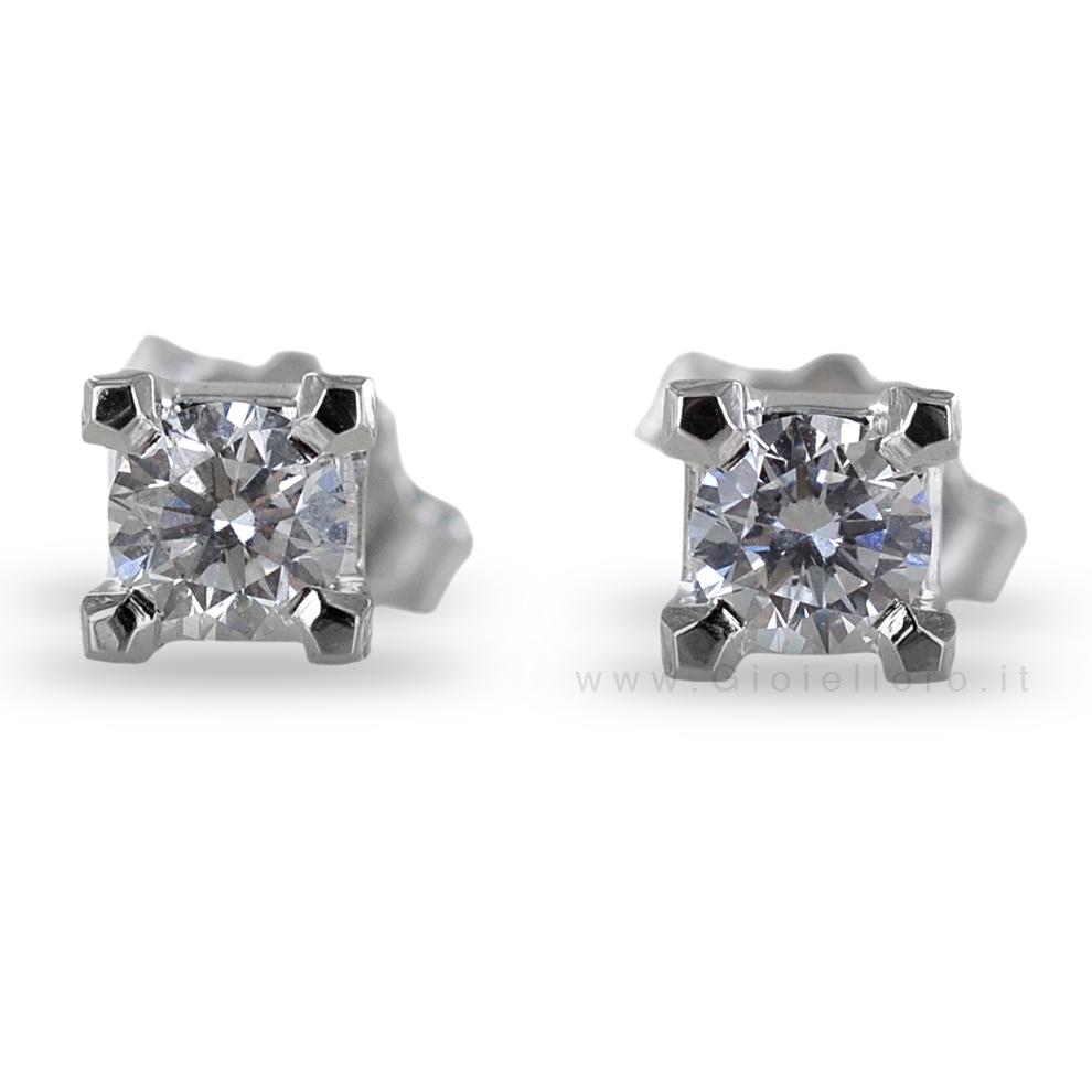 Orecchini punto luce medi con diamanti carati 0.20 F VS
