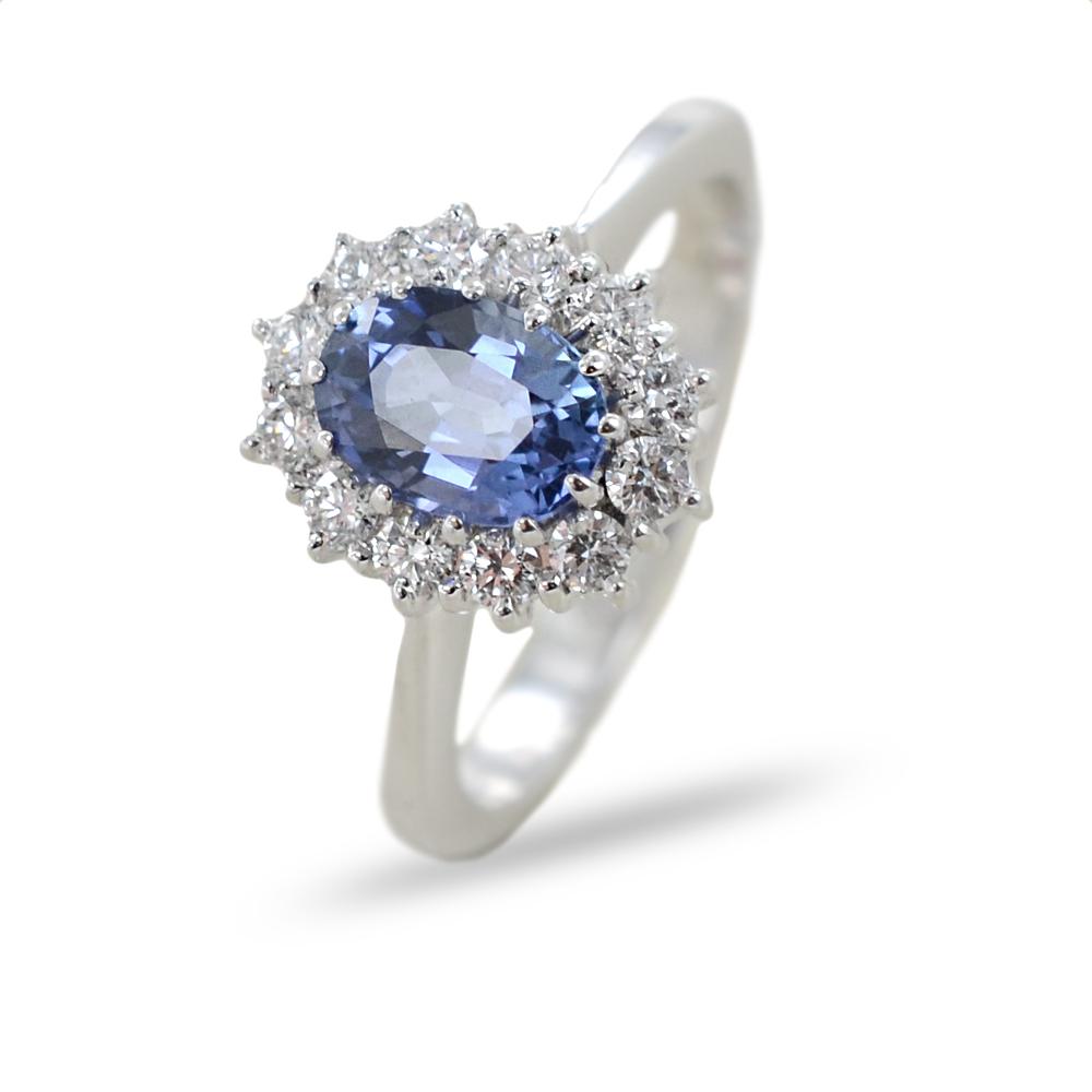 Anello classico in oro con Zaffiro da un carato e contorno di diamanti