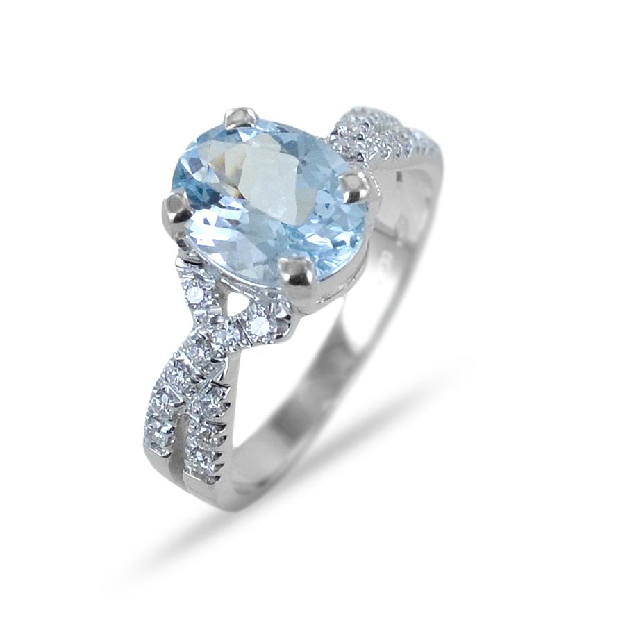 Anello con Acquamarina Ovale e doppia fascia di diamanti sul gambo