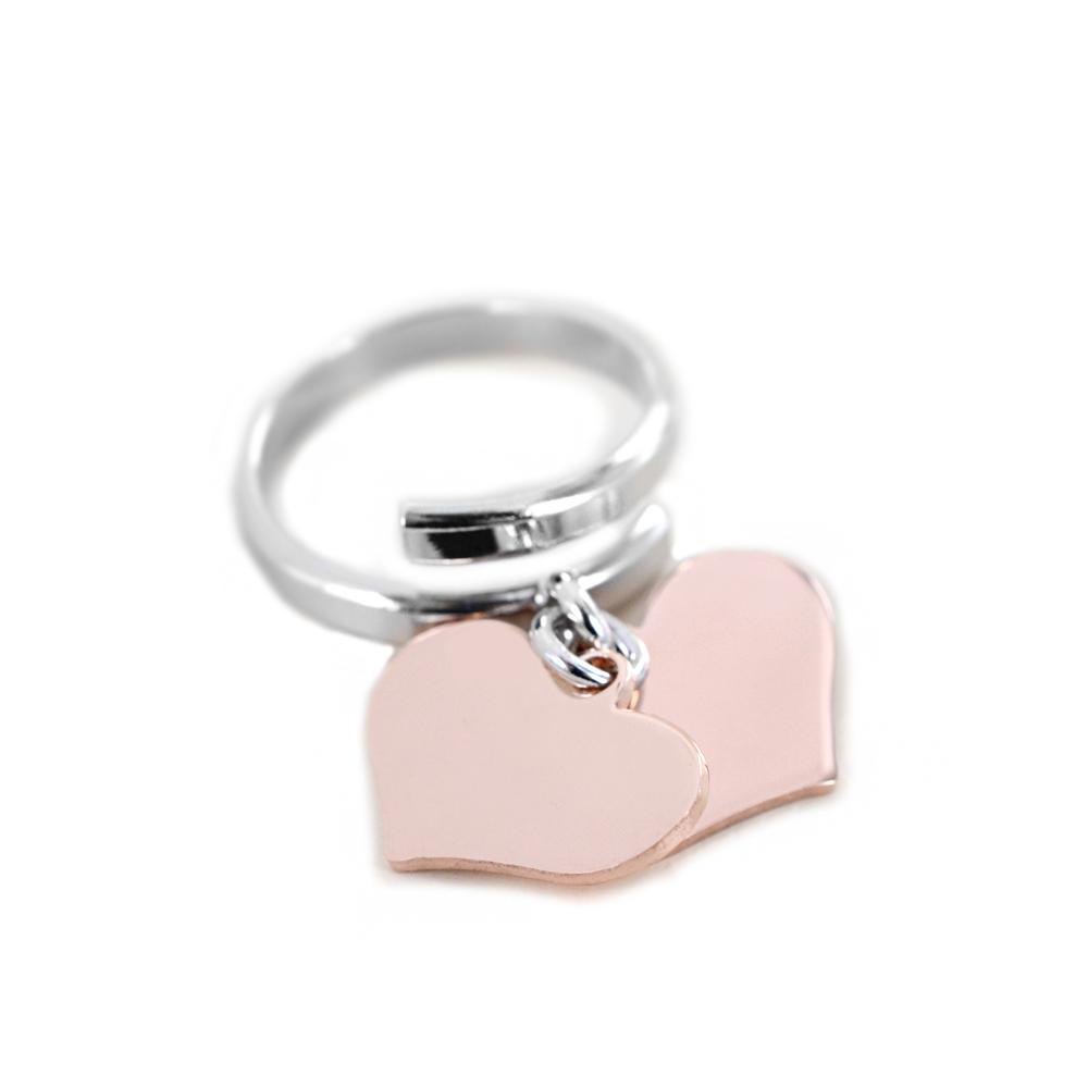 Anello con doppio ciondolo cuore pendente rosa in argento