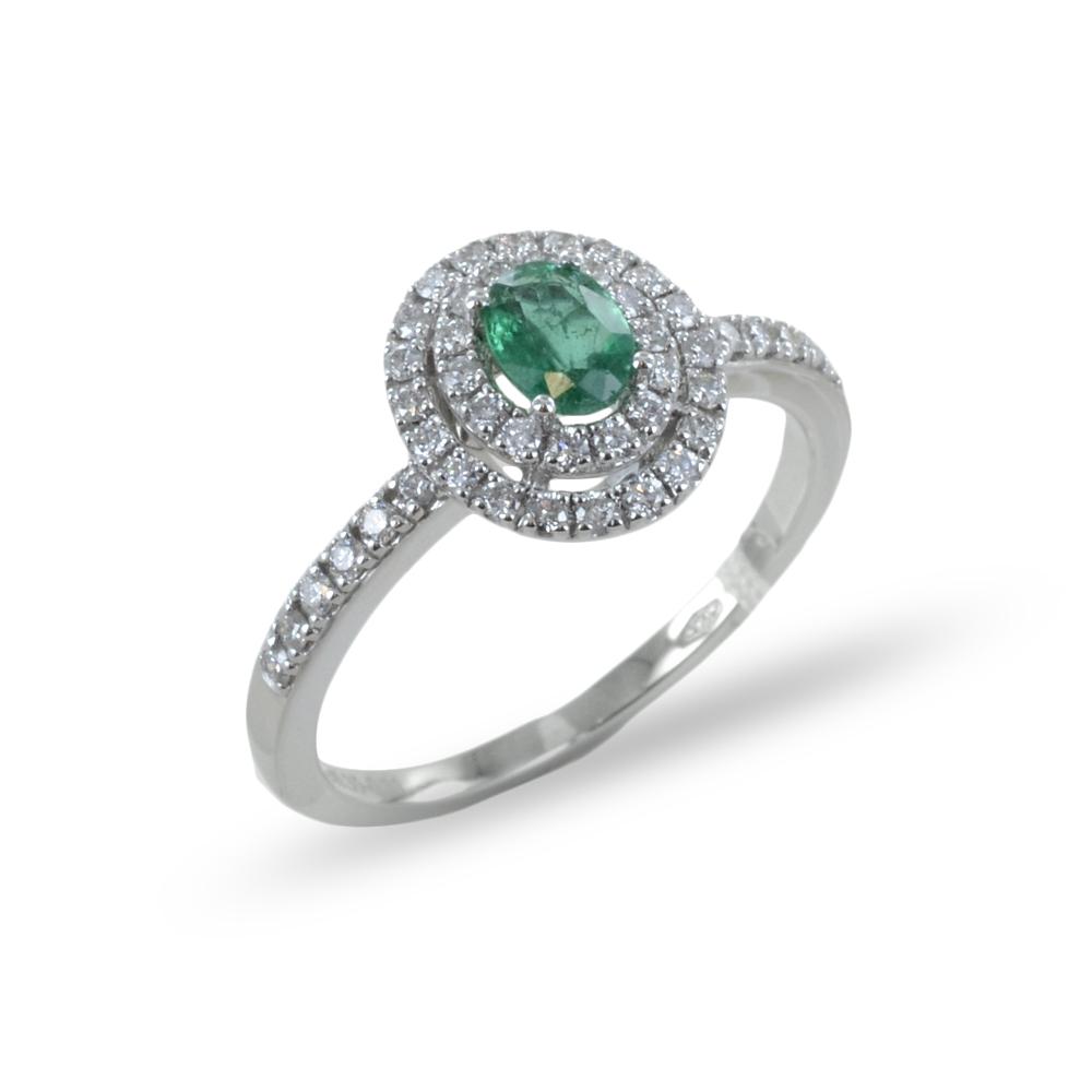 Anello con Smeraldo ovale e doppio contorno di diamanti