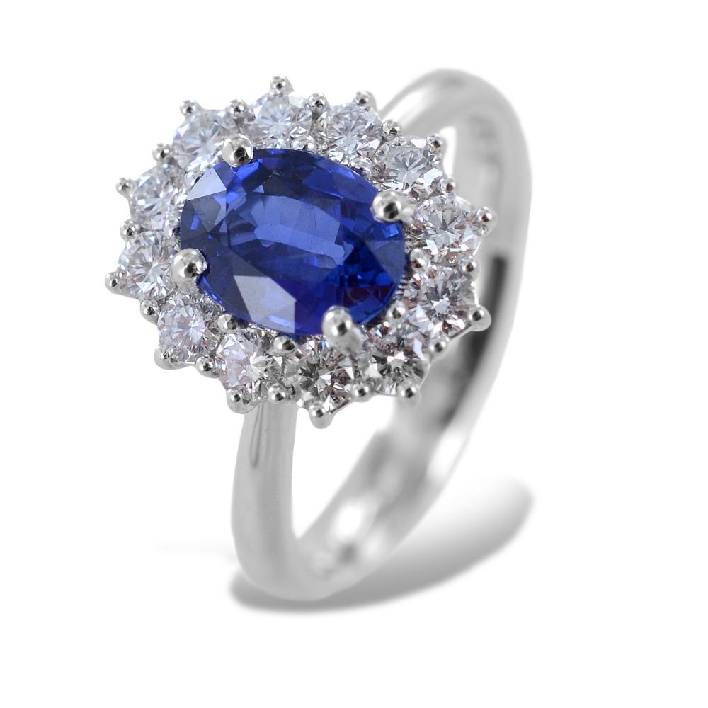 Anello con Zaffiro centrale da un carato e mezzo contorno di diamanti Gioielli Valenza