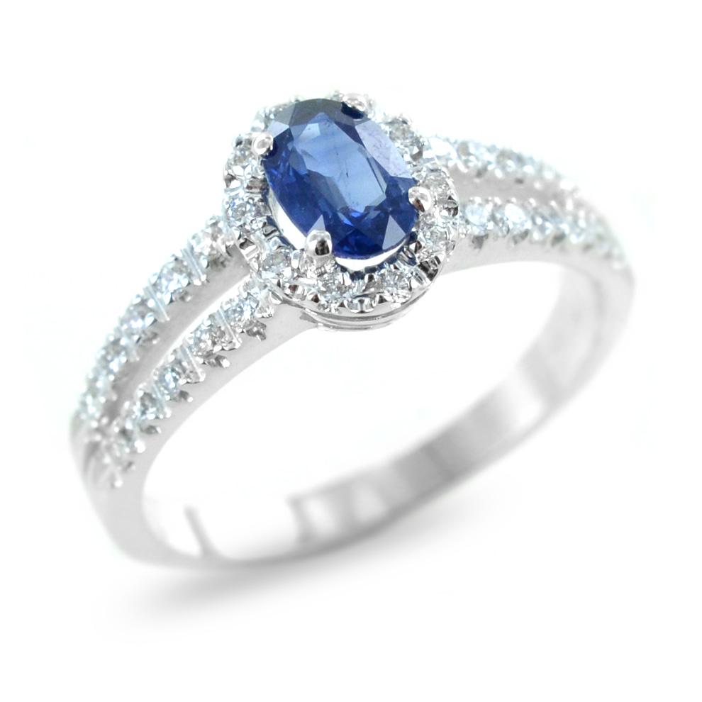 Anello con zaffiro e contorno di diamanti e diamanti sul gambo