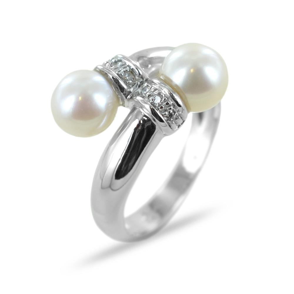 Anello contrarie di perle e diamanti