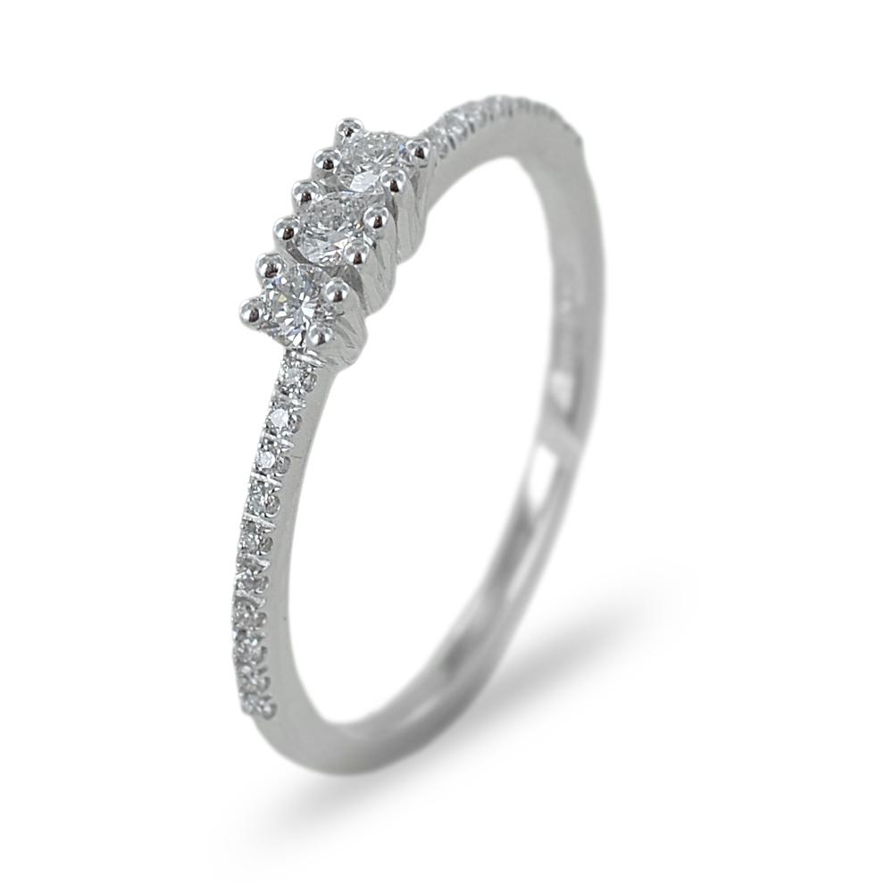 Anello Trilogy con diamanti sul gambo ct 0.21 colore G