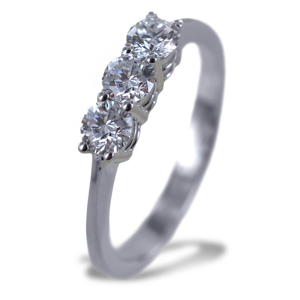 Anello Trilogy medio con diamanti oltre mezzo carato 0.60 ct