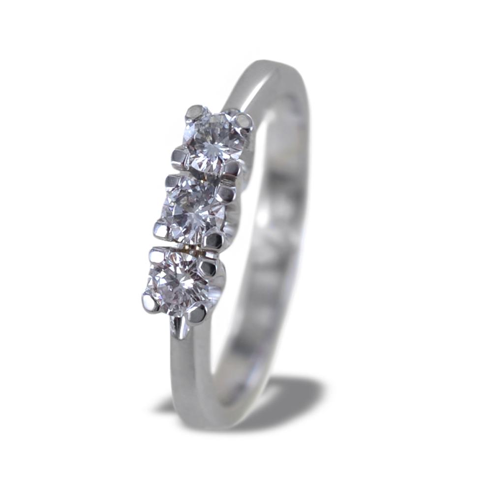 Anello Trilogy in oro e diamanti ct 0.30 colore G