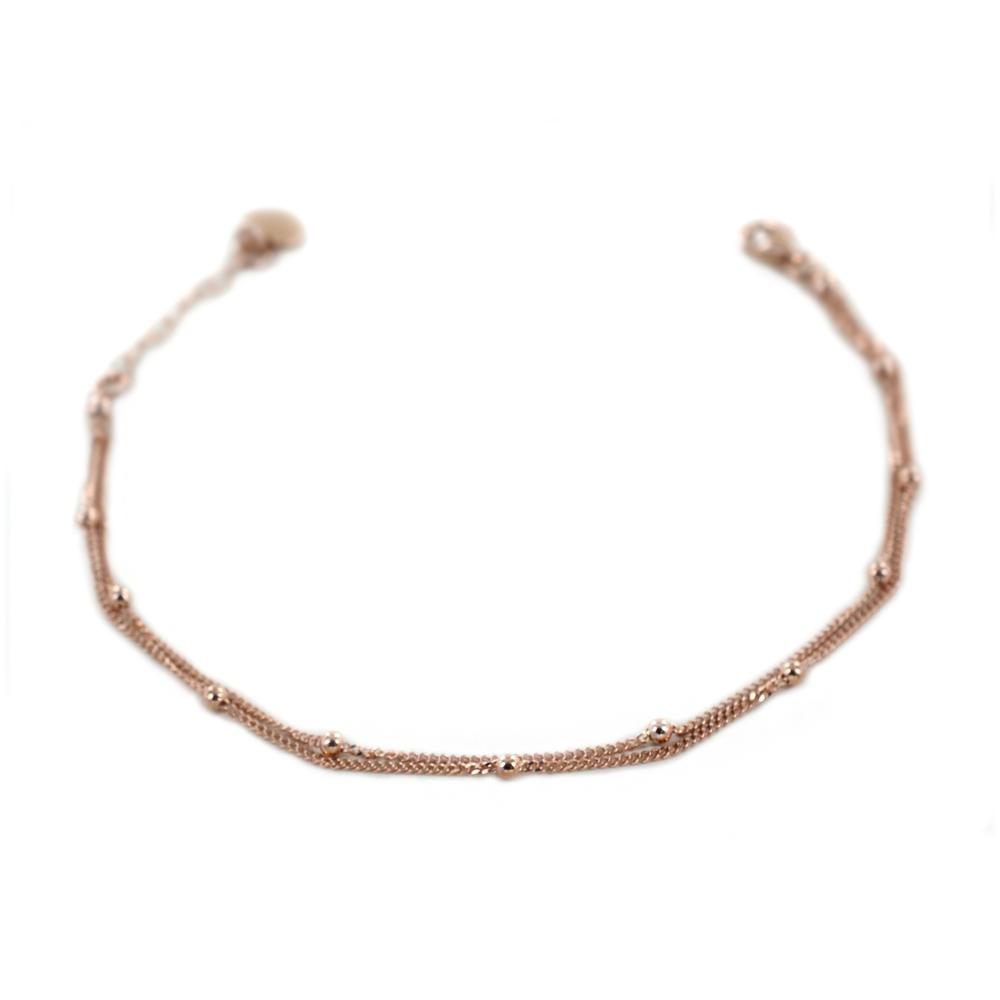 Bracciale in oro rosa a doppio filo con sfere luinose