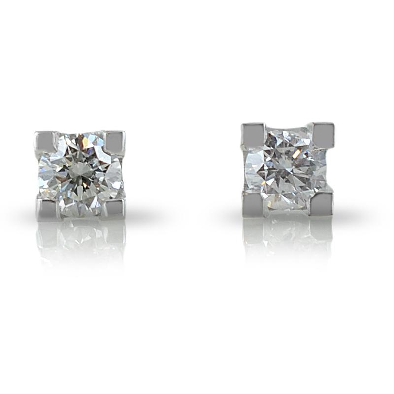 Orecchini punto luce medi in oro e diamanti ct 0.20 G VS