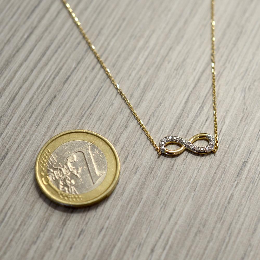aae5d0b2edae46 Collana con infinito in oro giallo e zirconi - pendente infinity - gallery 1